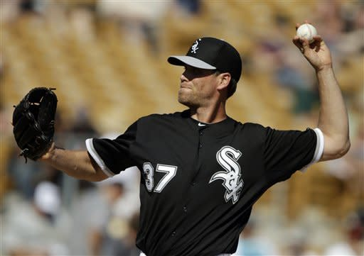 Chicago White Sox relief pitcher Matt Thornton delivers against the Oakland Athletics in the sixth inning of an exhibition spring training baseball game on Saturday, March 16, 2013, in Glendale, Ariz. (AP Photo/Mark Duncan)