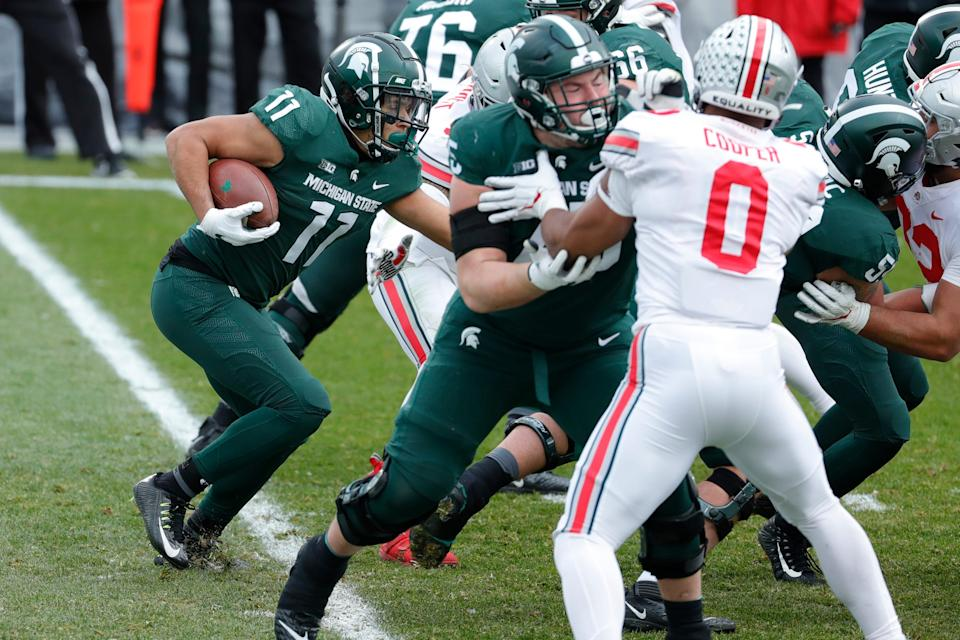 Michigan State running back Connor Heyward runs against Ohio State during the first half at Spartan Stadium in East Lansing on Saturday, Dec. 5, 2020.