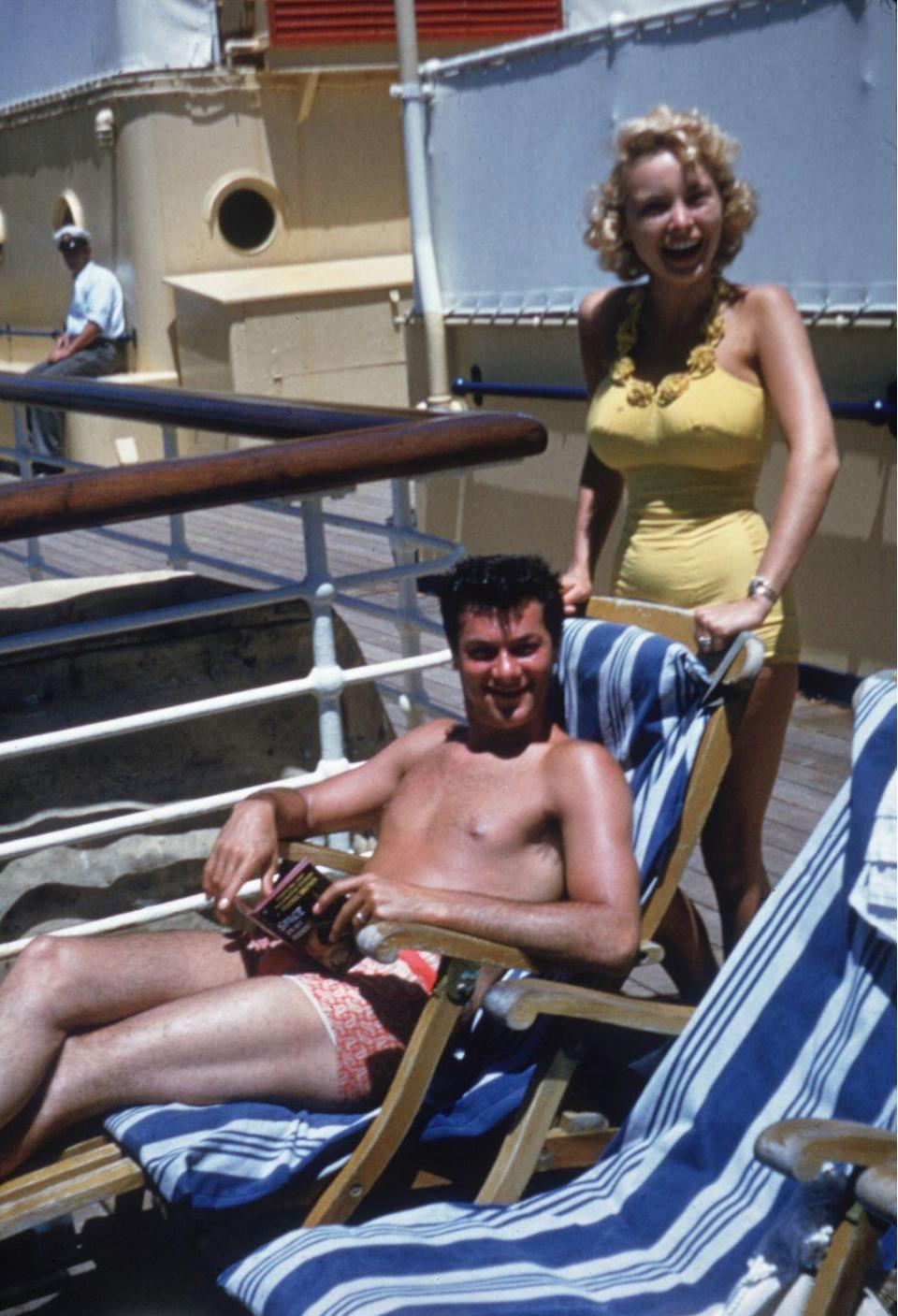 <p>American actors Janet Leigh and Tony Curtis smile aboard a cruise ship headed for Honolulu, Hawaii.</p><p>Other celebrity visitors this year: actor Richard Widmark, actor Clark Gable.</p>