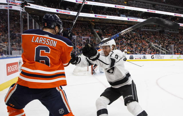 Los Angeles Kings' Adrian Kempe (9) checks Edmonton Oilers' Adam Larsson (6) during the first period of an NHL hockey game Saturday, March 24, 2018, in Edmonton, Alberta. (Jason Franson/The Canadian Press via AP)