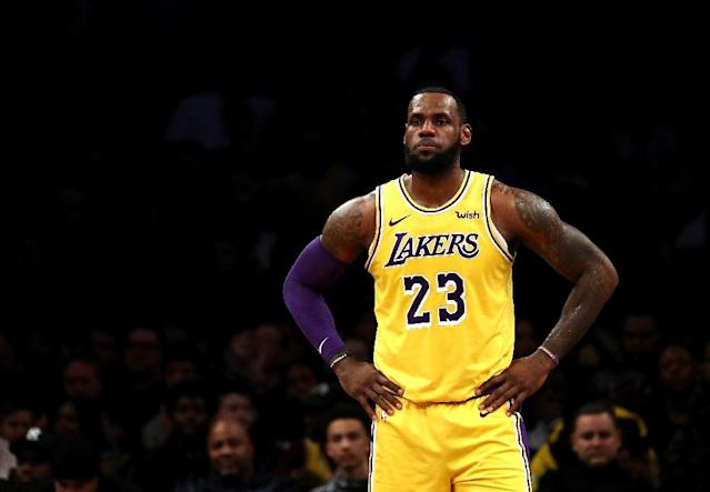 "LeBron James said missing a career-high 17 games because of a groin injury was the ""toughest stretch"" of his 16-year NBA career (AFP Photo/AL BELLO)"