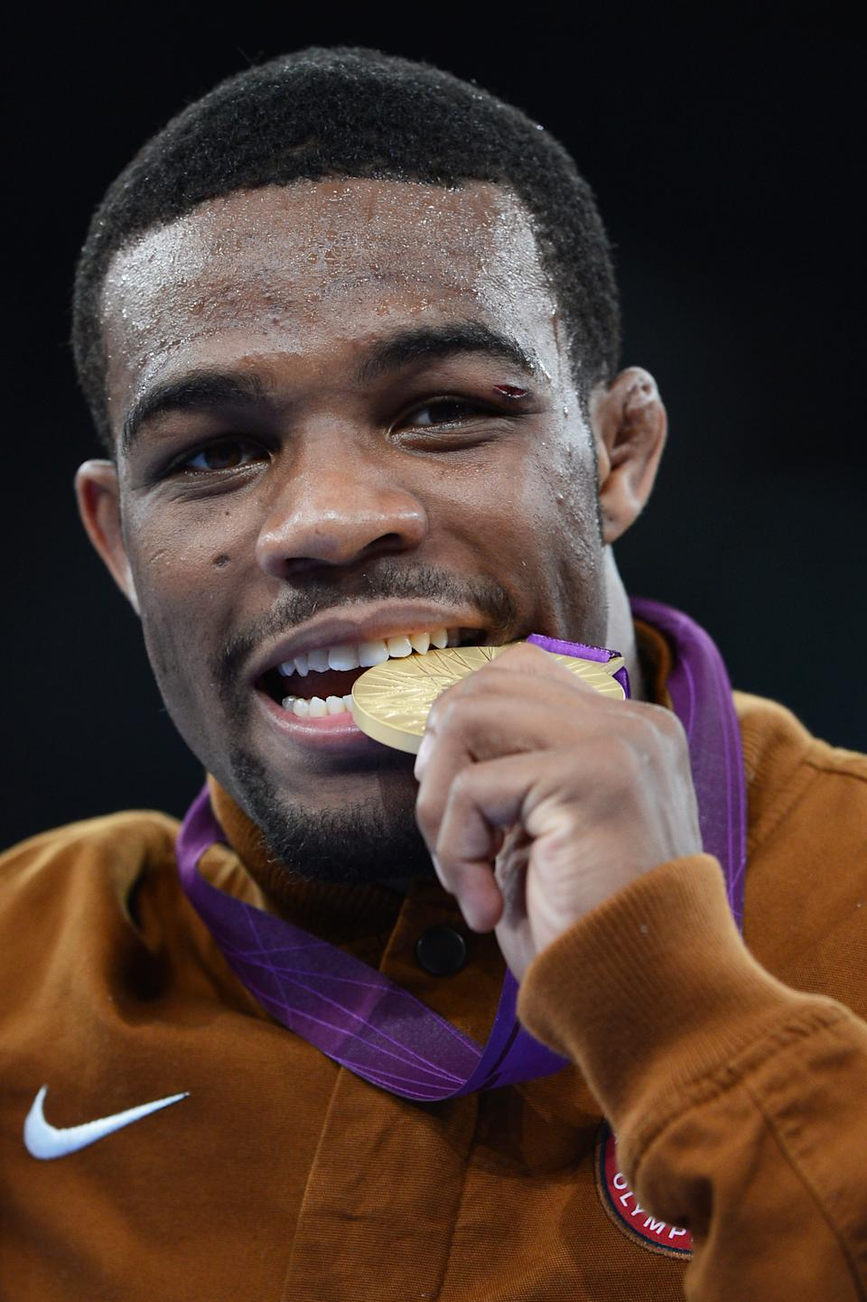 Jordan Ernest Burroughs of the United States celebrates his gold medal in the Men's Freestyle 74 kg Wrestling on Day 14 of the London 2012 Olympic Games at ExCeL on August 10, 2012 in London, England. (Photo by Michael Regan/Getty Images)