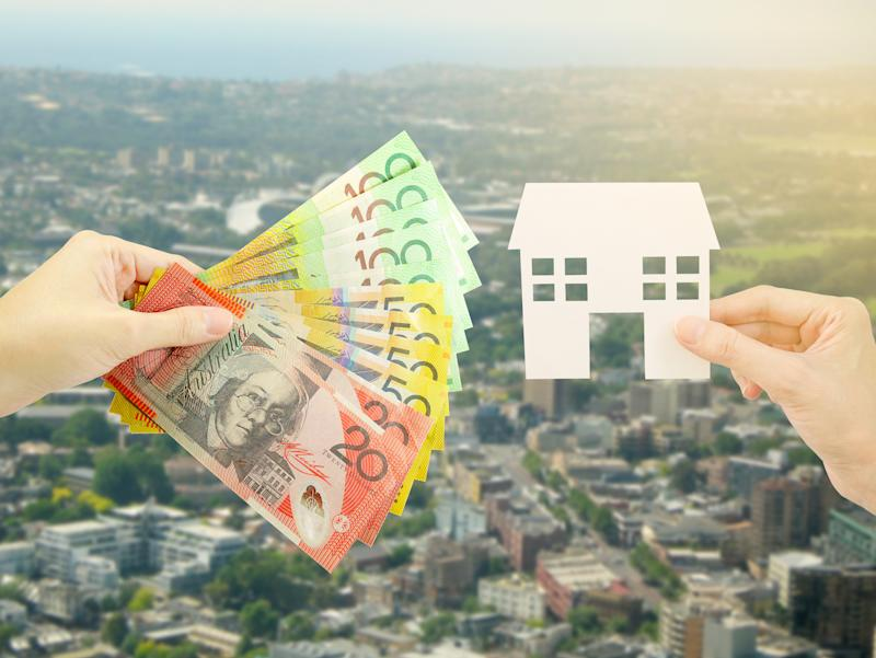 Pictured: Australian houses and Australian cash suggesting stamp property. Image: Getty