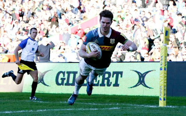 <span>Tim Swiel dives over the touchline to score for Quins</span> <span>Credit: rex </span>