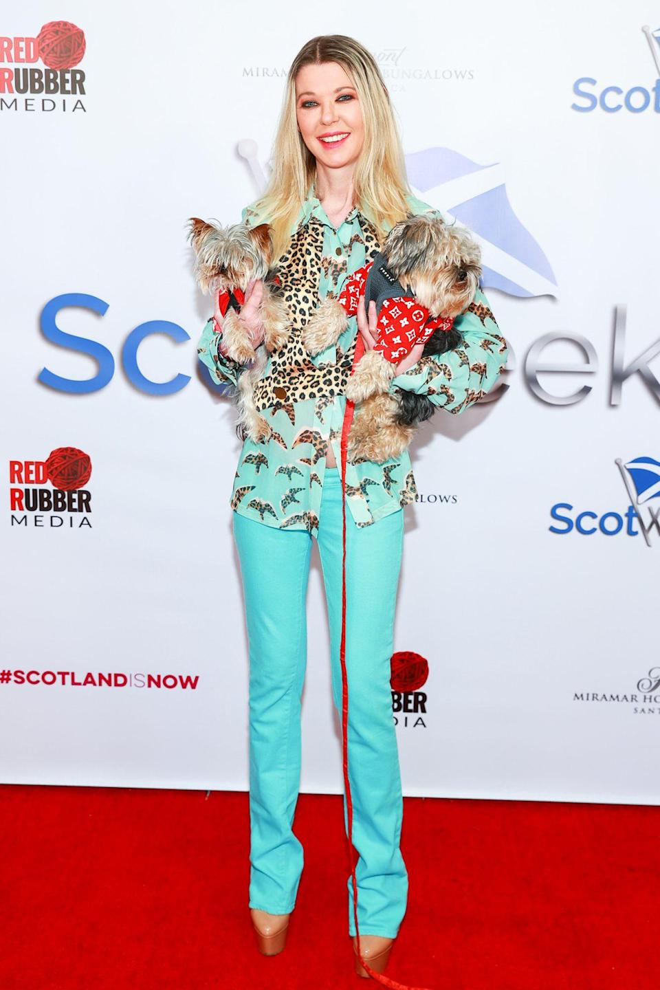 <p>Tara Reid poses with puppies at the ScotWeek red carpet launch party on Monday at Fairmont Miramar Hotel & Bungalows in Santa Monica. </p>