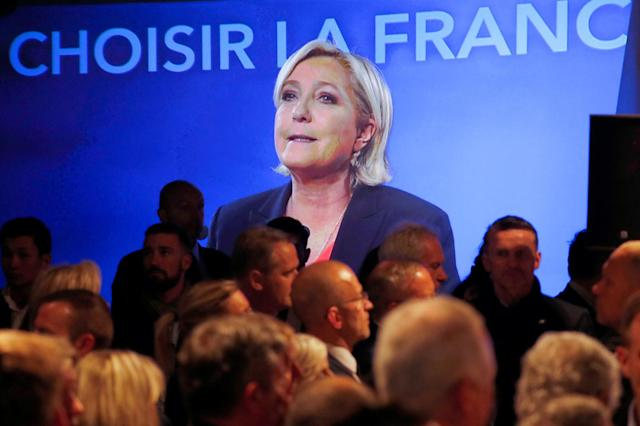 <p>French presidential candidate Marine Le Pen is shown on a screen while conceding defeat at the Chalet du Lac in the Bois de Vincennes in Paris, after the second round of 2017 French presidential election, May 7, 2017. (Charles Platiau/Reuters) </p>