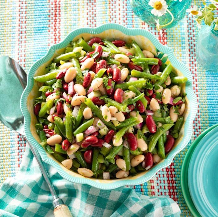 """<p>This simple bean salad is totally customizable. Add whatever beans you have on hand—chickpeas, lima beans, or wax beans—then change up the herbs based on what's growing in your garden. </p><p><a href=""""https://www.thepioneerwoman.com/food-cooking/recipes/a35889178/three-bean-salad/"""" rel=""""nofollow noopener"""" target=""""_blank"""" data-ylk=""""slk:Get the recipe."""" class=""""link rapid-noclick-resp""""><strong>Get the recipe. </strong></a></p><p><a class=""""link rapid-noclick-resp"""" href=""""https://go.redirectingat.com?id=74968X1596630&url=https%3A%2F%2Fwww.walmart.com%2Fsearch%2F%3Fquery%3Dcolanders&sref=https%3A%2F%2Fwww.thepioneerwoman.com%2Ffood-cooking%2Fmeals-menus%2Fg36353420%2Ffourth-of-july-side-dishes%2F"""" rel=""""nofollow noopener"""" target=""""_blank"""" data-ylk=""""slk:SHOP COLANDERS"""">SHOP COLANDERS</a></p>"""