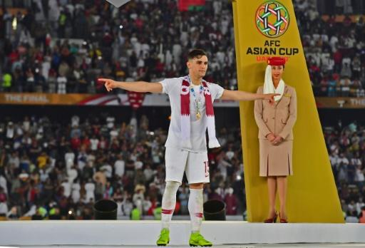 Qatar's defender Bassam al-Rawi celebrating his team's win over Japan during the 2019 AFC Asian Cup final football match in Abu Dhabi