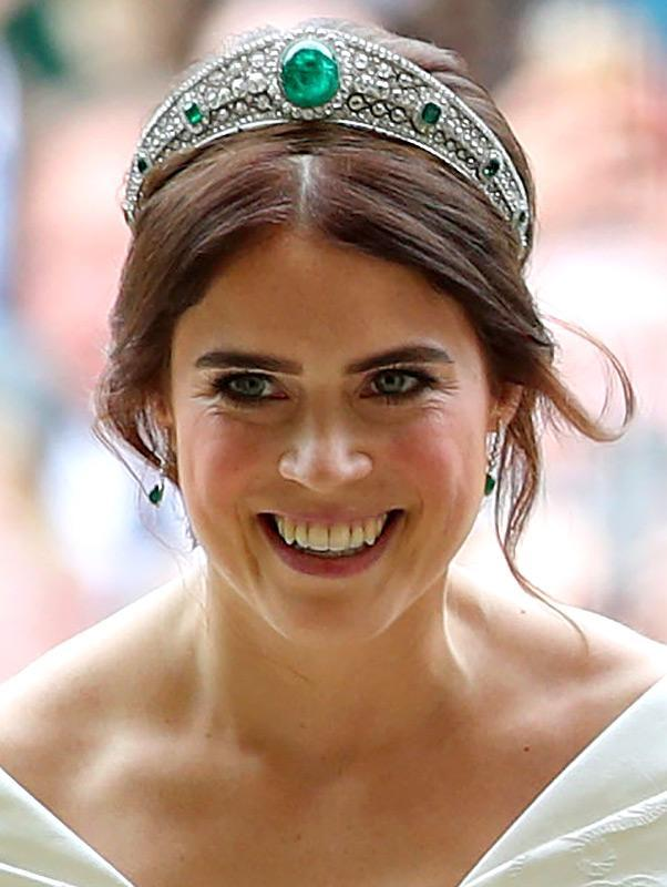 <p>Queen Elizabeth let her granddaughter Princess Eugenie don this stunning diamond and emerald headpiece for her 2018 wedding day. Dame Margaret Greville left the tiara to the Queen Mother when she died in 1942. When the Queen Mother passed away in 2002, the tiara was passed down to the monarch.</p>