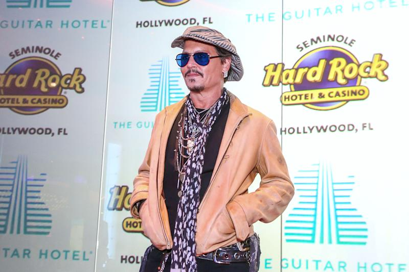 US actor Johnny Depp attends the Grand Opening of the Guitar Hotel expansion at Seminole Hard Rock Hotel & Casino Hollywood, in Hollywood, Florida, October 24, 2019. (Photo by Zak BENNETT / AFP) (Photo by ZAK BENNETT/AFP via Getty Images)
