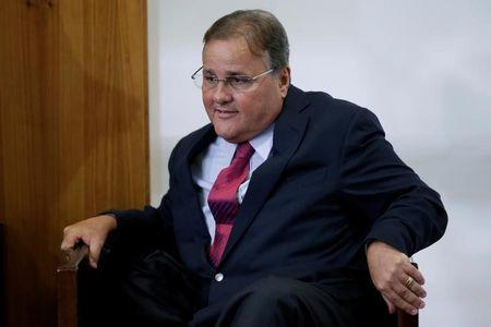 Brazilian minister Geddel Vieira Lima gestures during a meeting with deputies and government leaders of the Chamber of Deputies, in his office at the Planalto Palace in Brasilia