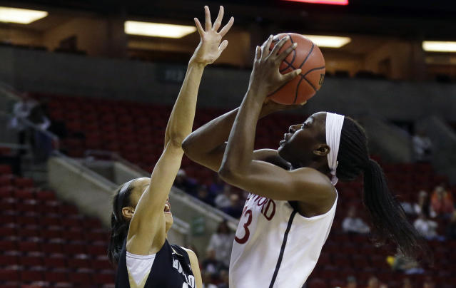 Stanford forward Chiney Ogwumike, right, shoots against the defense of Colorado forward Arielle Roberson, left, in the first half of an NCAA college basketball game in the second round of the Pac-12 women's tournament on Friday, March 7, 2014, in Seattle. Stanford won 69-54. (AP Photo/Ted S. Warren)