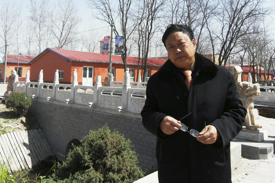 In this April 2, 2010 photo provided by the Legal Team of Dawu Group, Sun Dawu stands in Baoding in northern China's Hebei Province. A prominent Chinese pig farmer who was detained after praising lawyers during a crackdown on legal activists by President Xi Jinping's government has been se,ntenced to 18 years in prison on charges of organizing an attack on officials and other offenses. (Legal Team of Dawu Group via AP)