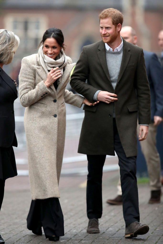 "<p>Markle sported an oatmeal-colored coat from <a href=""https://shopsmythe.com/"" rel=""nofollow noopener"" target=""_blank"" data-ylk=""slk:Smythe"" class=""link rapid-noclick-resp"">Smythe</a> (sold out, naturally), black trousers from Burberry, <a href=""https://www.sarahflint.com/collections/pumps/products/jay-pump-100-black-suede?variant=28249886273"" rel=""nofollow noopener"" target=""_blank"" data-ylk=""slk:pumps from Sarah Flint"" class=""link rapid-noclick-resp"">pumps from Sarah Flint</a>, and a messy bun for her <a href=""https://www.townandcountrymag.com/society/tradition/g14784312/prince-harry-meghan-markle-second-official-appearance-photos/"" rel=""nofollow noopener"" target=""_blank"" data-ylk=""slk:second official royal engagement in Brixton"" class=""link rapid-noclick-resp"">second official royal engagement in Brixton</a>. </p>"