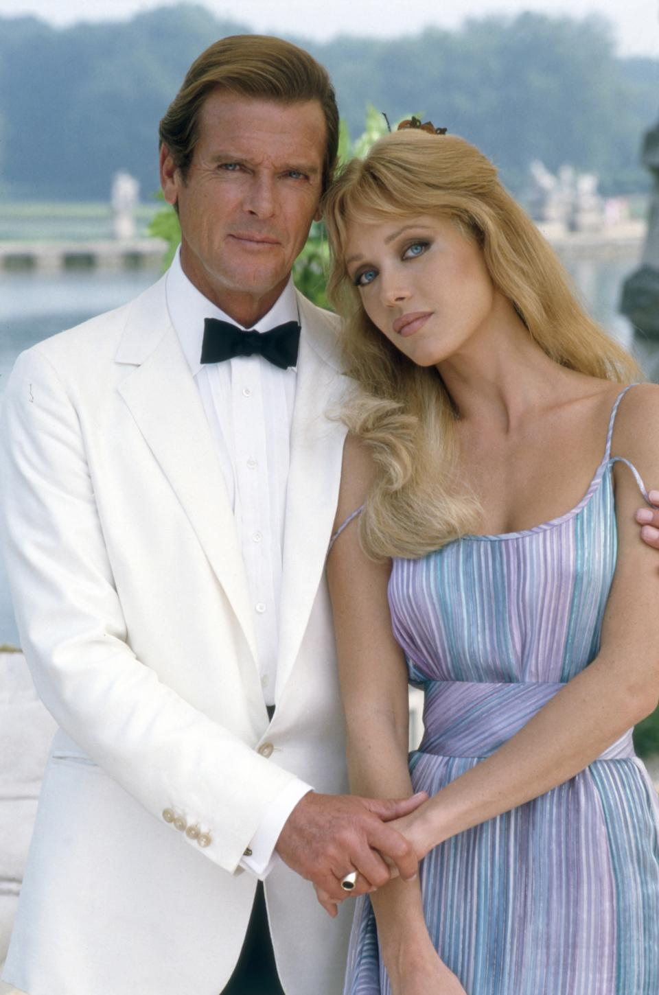 """Actor Roger Moore and actress Tanya Roberts on the set of """"View To Kill""""."""
