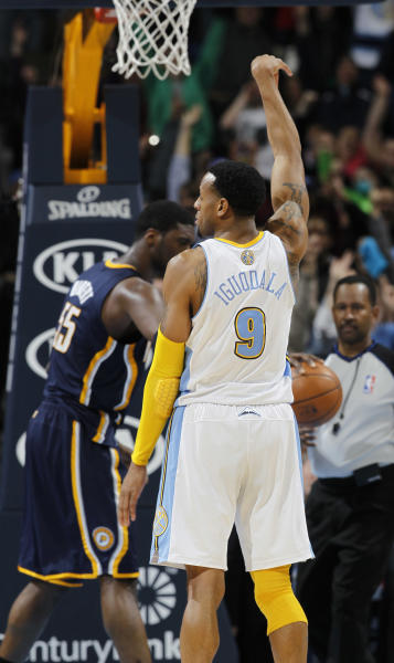 Denver Nuggets guard Andre Iguodala, front, reacts after hitting a free throw to provide the margin of victory with four-tenths of second remaining in the fourth quarter as Indiana Pacers center Roy Hibbert retrieves the ball in the Nuggets' 102-101 victory in an NBA basketball game in Denver on Monday, Jan. 28, 2013. (AP Photo/David Zalubowski)