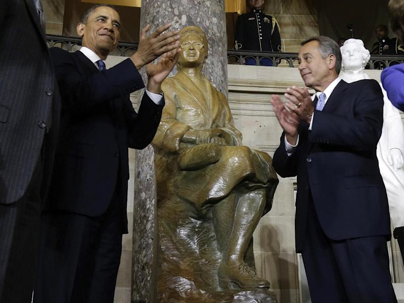 President Barack Obama and House Speaker John Boehner of Ohio applaud at the unveiling of a statue of Rosa Parks, Wednesday, Feb. 27, 2013, on Capitol Hill in Washington. (AP Photo/Charles Dharapak)