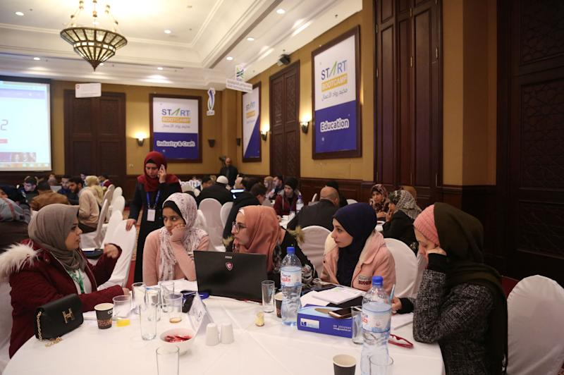 "Nada Rudwan (L), 27, a graduate of English faculty, takes part in a startup workshop in Gaza City, Jan. 29, 2019. ""It was difficult to find a job, so I thought of doing something I like and that will make me money at the same time,"" said Rudwan, who posts cooking tutorials to social media platforms under the name ""Nada Kitchen"". ""It is an attempt to beat the physical blockade of Gaza by finding a job that just needs some talent, a camera and internet connection,"" she added. (Photo: Samar Abo Elouf/Reuters)"