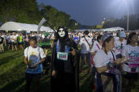 """A supporter of the anti-military Future Forward Party in a costume gather for a run dubbed as """"Run Against Dictatorship"""" at a park in Bangkok, Thailand, Sunday, Jan. 12, 2020. About 6000 runners participated in a 3 KM. (1.86 mile) run to demonstrate against the government led by former army general Prayuth Chan-ocha. (AP Photo/Gemunu Amarasinghe)"""