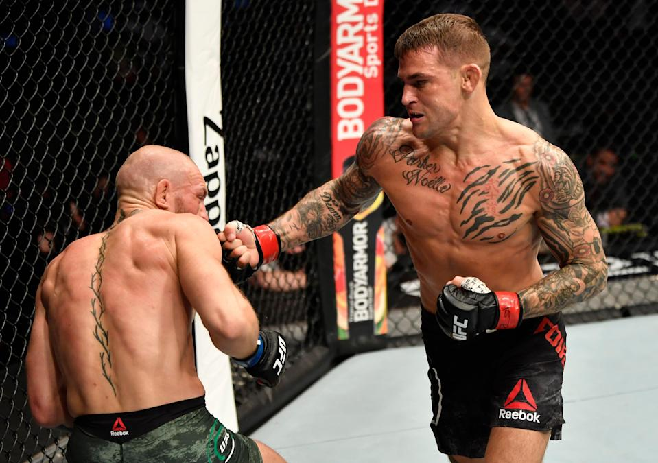 <p>Dustin Poirier knocks out Conor McGregor in the pair's UFC rematch in January</p> (Zuffa LLC via Getty Images)
