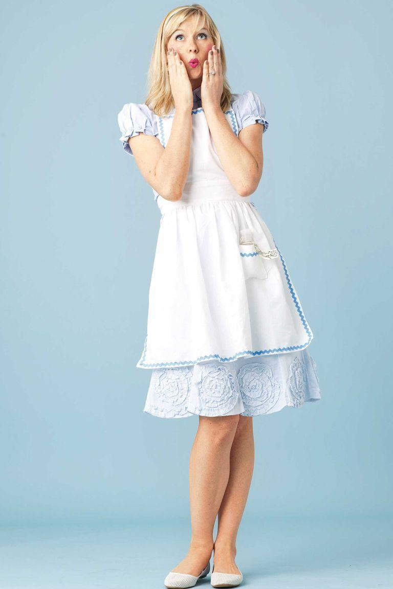 """<p>To transform yourself into Alice herself, start with a light blue puff sleeve dress or shirt-and-skit combo. Add a white bib apron edged with light-blue rickrack, as well as a pair of white flats and a white headband.</p><p><a class=""""link rapid-noclick-resp"""" href=""""https://www.amazon.com/R-Vivimos-Womens-Summer-Ruffled-LightBlue/dp/B08DKYHT1P?tag=syn-yahoo-20&ascsubtag=%5Bartid%7C10070.g.490%5Bsrc%7Cyahoo-us"""" rel=""""nofollow noopener"""" target=""""_blank"""" data-ylk=""""slk:SHOP BLUE DRESSES"""">SHOP BLUE DRESSES</a></p>"""