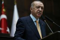 Turkish President Erdogan addresses members of his ruling AKP during a meeting in Ankara