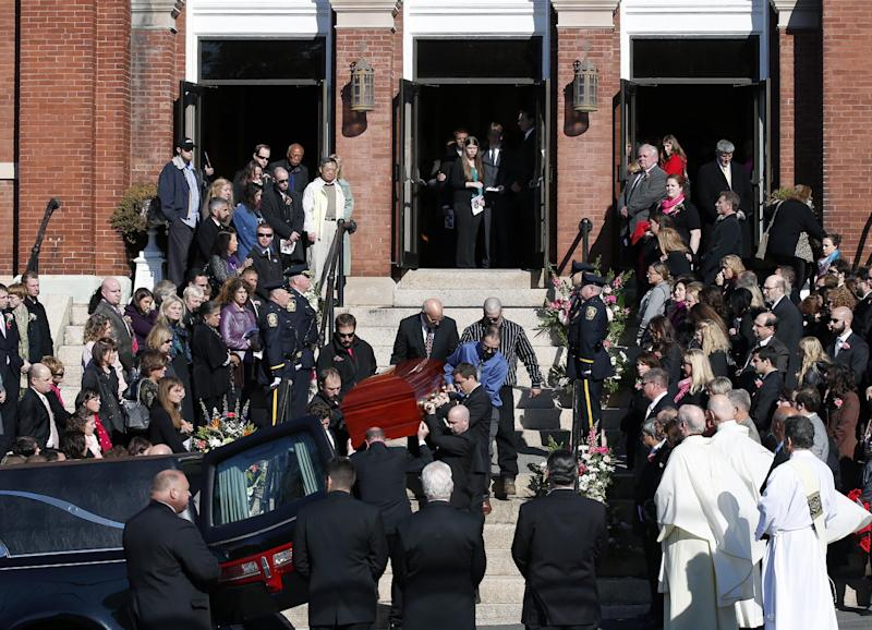 Mourners line the steps of St. Augustine Church in Andover, Mass., Monday Oct. 28, 2013, as the casket of slain Danvers High School teacher Colleen Ritzer is carried out from her funeral Mass into a hearse. (AP Photo/Elise Amendola)