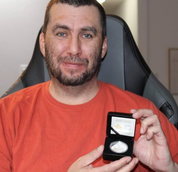 Jason Sikoak, shortly after getting to see the coin he designed for the very first time.  (Submitted by Jason Sikoak - image credit)