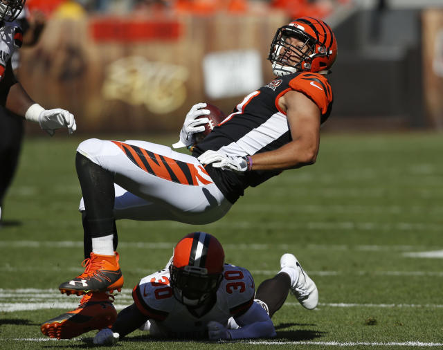 <p>Cincinnati Bengals tight end C.J. Uzomah (87) is tackled by Cleveland Browns defensive back Jason McCourty (30) in the second half of an NFL football game, Sunday, Oct. 1, 2017, in Cleveland. (AP Photo/Ron Schwane) </p>