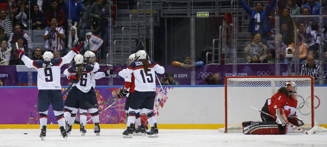 Team USA celebrates a third period goal against Canada during the women's gold medal ice hockey game at the 2014 Winter Olympics, Thursday, Feb. 20, 2014, in Sochi, Russia. (AP Photo/Matt Slocum)