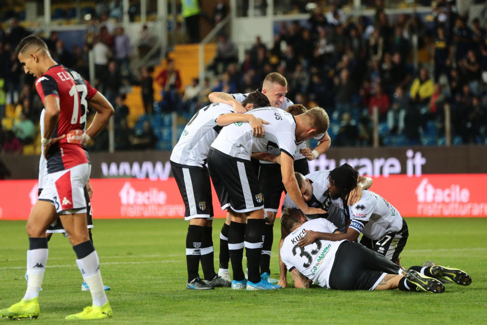 Parma's Jurai Kucka, third from right on the ground, celebrates after scoring during a Serie A soccer match between Parma and Genoa at the Ennio Tardini stadium in Parma, Italy, Sunday, Oct. 20, 2019. (Serena Campanini/ANSA via AP)