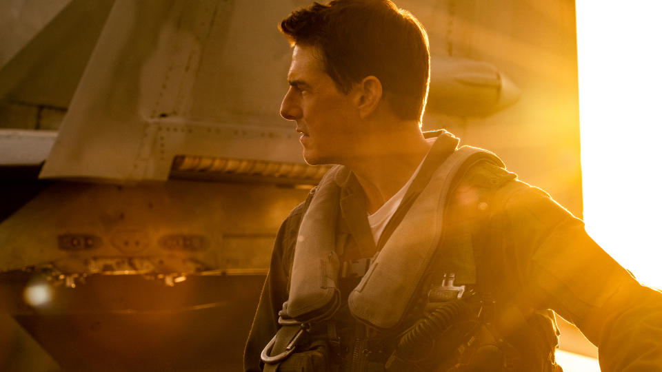 "Tom Cruise is seemingly set to attempt to break the <a href=""https://uk.movies.yahoo.com/tom-cruises-most-dangerous-stunts-134115544.html"" data-ylk=""slk:stunts per year record;outcm:mb_qualified_link;_E:mb_qualified_link;ct:story;"" class=""link rapid-noclick-resp yahoo-link"">stunts per year record</a> in 2021 thanks to the delay to this belated sequel to the 1980s classic <em>Top Gun</em> and, of course, another big franchise effort. More on that later. Joseph Kosinski's film sees Cruise reprise the role of test pilot Maverick and will feature Miles Teller as Rooster — son of Maverick's late friend Goose. (Credit: Paramount)"