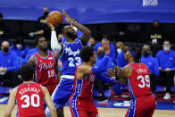 Los Angeles Lakers' LeBron James (23) goes up for a shot against Philadelphia 76ers' Dwight Howard (39), Matisse Thybulle (22), Shake Milton (18) and Furkan Korkmaz (30) during the first half of an NBA basketball game, Wednesday, Jan. 27, 2021, in Philadelphia. (AP Photo/Matt Slocum)