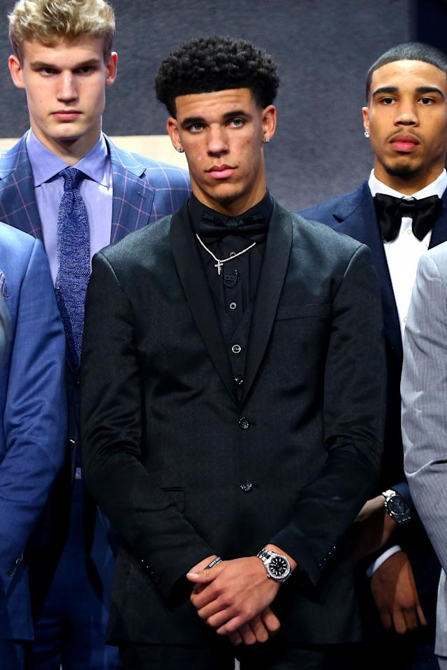 <p>Lonzo Ball poses on stage before the first round of the 2017 NBA Draft at Barclays Center on June 22, 2017 in New York City. </p>