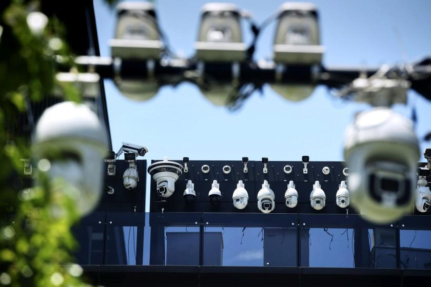 This picture shows Dahua surveillance cameras being installed on the Dahua Technologies office building in Hangzhou, in east China's Zhejiang province on May 29, 2019. (Photo by STR / AFP) / China OUT (Photo by STR/AFP via Getty Images)
