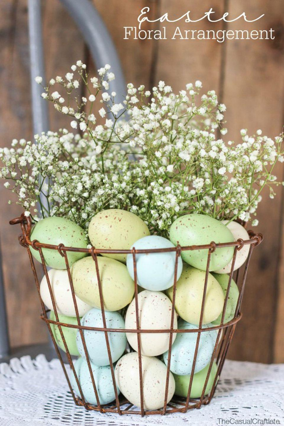 """<p>Sometimes it's the most simple ideas that are the most beautiful, such as this <a href=""""https://www.housebeautiful.com/entertaining/holidays-celebrations/g4242/easter-basket-ideas/"""" rel=""""nofollow noopener"""" target=""""_blank"""" data-ylk=""""slk:egg-filled basket"""" class=""""link rapid-noclick-resp"""">egg-filled basket</a> topped with a plume of baby's breath.</p><p><em><a href=""""http://www.thecasualcraftlete.com/2015/03/24/easter-floral-arrangement/"""" rel=""""nofollow noopener"""" target=""""_blank"""" data-ylk=""""slk:Get the tutorial from The Casual Craftlete »"""" class=""""link rapid-noclick-resp"""">Get the tutorial from The Casual Craftlete »</a></em></p><p>Jungalow Double Hoop Planet, $59 <a class=""""link rapid-noclick-resp"""" href=""""https://www.jungalow.com/products/double-hoop-planter?_pos=5&_sid=a967a4e8c&_ss=r"""" rel=""""nofollow noopener"""" target=""""_blank"""" data-ylk=""""slk:BUY NOW"""">BUY NOW</a></p>"""
