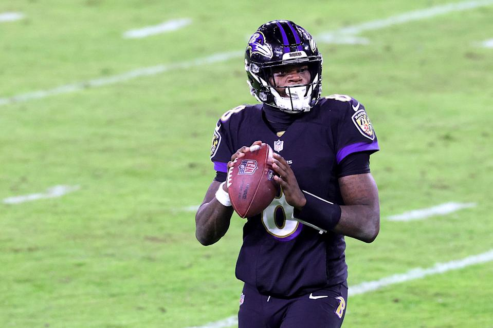 The Ravens are being fined $250,000 for their late November COVID-19 outbreak, which affected 23 players including quarterback Lamar Jackson. (Photo by Rob Carr/Getty Images)