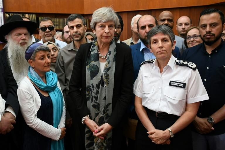 Britain's Prime Minister Theresa May (C) and Metropolitan Police Commissioner, Cressida Dick (C-R) talk to faith leaders at Finsbury Park Mosque in north London on June 19, 2017