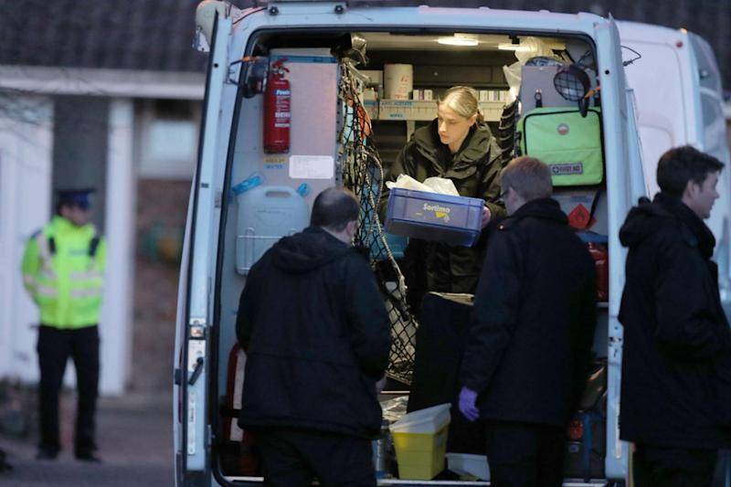 Police at the home of Sergei Skripal last night in Salisbury (PA)