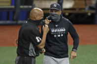 New York Yankees manager Aaron Boone, right, argues with home plate umpire Vic Carapazza during the fifth inning of the second game of a doubleheader baseball game against the Tampa Bay Rays Saturday, Aug. 8, 2020, in St. Petersburg, Fla. The Yankees were upset when Rays relief pitcher Andrew Kittredge threw an inside pitch to DJ LeMahieu. Boone was eventually ejected. (AP Photo/Chris O'Meara)