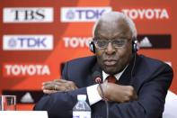 FILE PHOTO: Outgoing President of IAAF Lamine Diack attends a news conference in Beijing