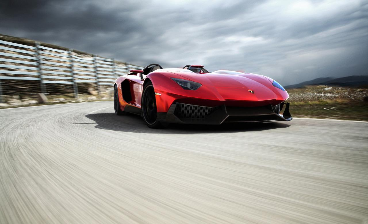 "Starting with the everyday 700-hp Aventador, Lamborghini taunted the bull even further by removing the roof, adding several aerodynamic panels and generally shucking weight from a car that only had 3,472 lbs. to begin with. Even the seat fabrics have been swapped for something Lamborghini calls ""Carbonskin,"" a fabric made from carbon fibers that's at least a decade away from being used on a teenager's hat. With no windshield, the interior has to get some form of waterproofing; the rear mirror pops up like Wall-E's head from the center of the dash. It and the roll bars behind the driver are the highest points in the car."