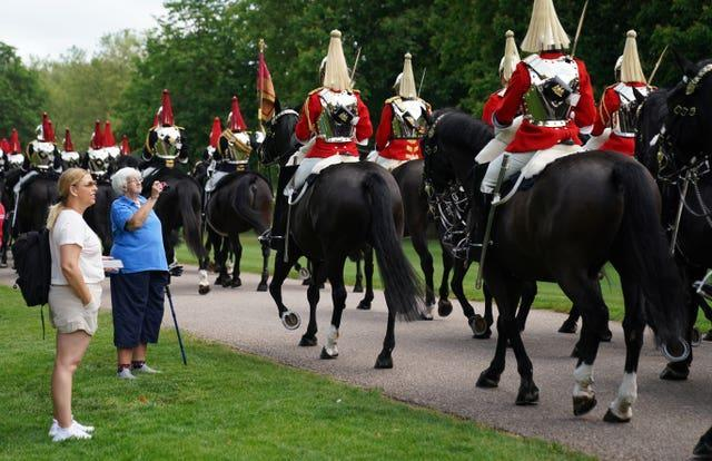 Members of the Household Cavalry make their way down the Long Walk towards Windsor Castle ahead of the ceremony