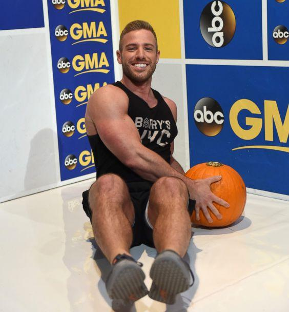 PHOTO: Barry's Bootcamp trainer Josey Greenwell demonstrates the pumpkin seated Russian twist. (Paula Lobo/ABC News)