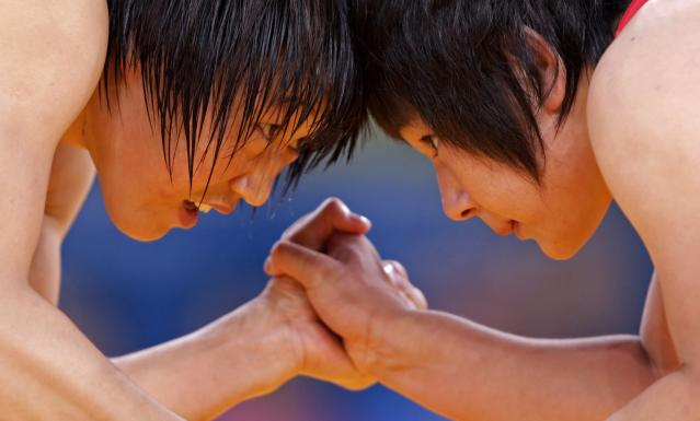 China's Ruixue Jing (L) fights with North Korea's Un Gyong Choe on the Women's 63Kg Greco-Roman wrestling at the ExCel venue during the London 2012 Olympic Games August 8, 2012. REUTERS/Toru Hanai (BRITAIN - Tags: OLYMPICS SPORT WRESTLING TPX IMAGES OF THE DAY)