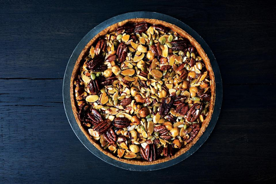"Yes, a press-in crust is easier to make and handle than a buttery dough that you have to roll out, but there's still some technique to doing it correctly. <a href=""https://www.epicurious.com/recipes/food/views/caramelized-honey-nut-and-seed-tart-56390106?mbid=synd_yahoo_rss"" rel=""nofollow noopener"" target=""_blank"" data-ylk=""slk:See recipe."" class=""link rapid-noclick-resp"">See recipe.</a>"