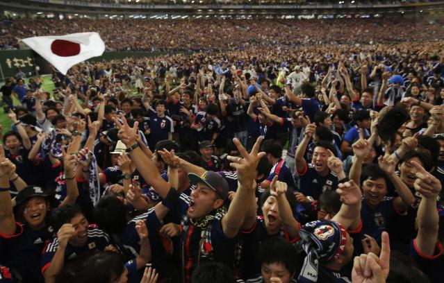 Japan's supporters react after Japan's first goal by Keisuke Honda as they watch the team's 2014 World Cup Group C soccer match against Ivory Coast on a big screen during a public viewing event at Tokyo dome June 15, 2014. REUTERS/Yuya Shino (JAPAN - Tags: TPX IMAGES OF THE DAY SPORT SOCCER WORLD CUP SOCIETY)