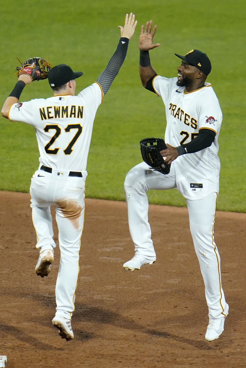 Pittsburgh Pirates' Kevin Newman, left, celebrates with Gregory Polanco, right, after getting the final out of a baseball game against the Chicago White Sox in Pittsburgh, Tuesday, June 22, 2021. (AP Photo/Gene J. Puskar)