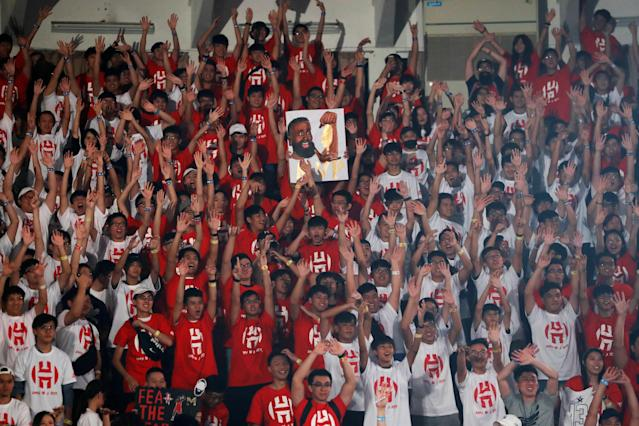 Fans of NBA player James Harden of the Houston Rockets wave during a promotional event in Taipei, Taiwan July 5, 2018. REUTERS/Tyrone Siu