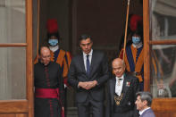 Spain's Prime Minister Pedro Sanchez, center, leaves the San Damaso courtyard after his meeting with Pope Francis, at the Vatican, Saturday, Oct. 24, 2020. (AP Photo/Alessandra Tarantino)